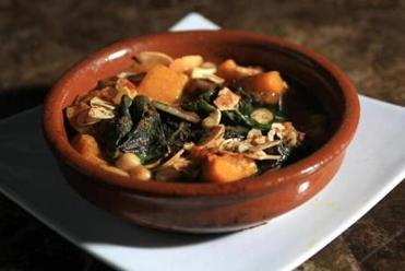 Potaje Andaluz, a dish of sauteed rainbow chard, butternut squash, chickpeas, almonds, golden raisons at Estragon.
